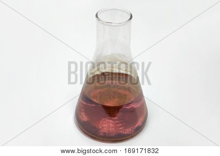 Erlenmeyer flask with potassium permanganate solution. Horizontal