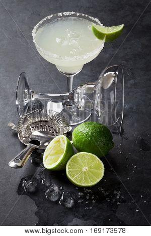 Margarita cocktail on dark stone table