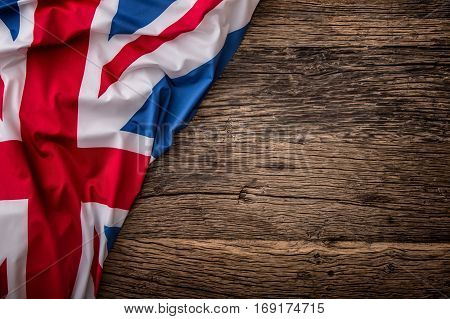 Flag of UK on old wooden background. Union Jack flag on old oak background.