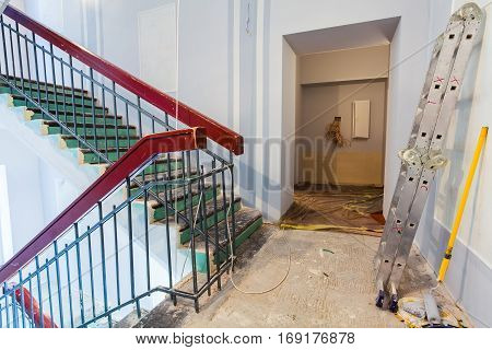 Stairs and ladder are the part of interior of apartment during on the renovation and construction