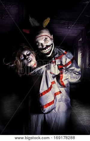 horror clown with woman head in mad house