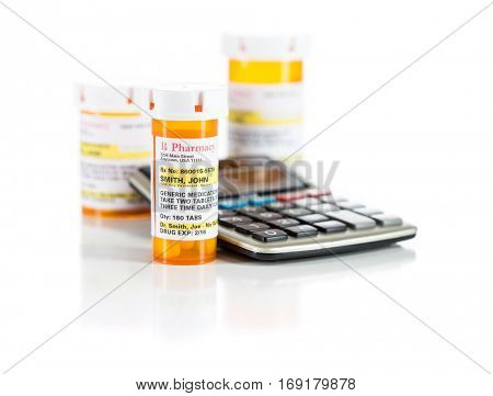 Calculator and Non-Proprietary Medicine Prescription Bottles Isolated on a White Background. These are labels with fictitious information applied.