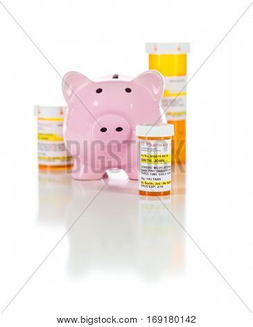 Piggy Bank and Non-Proprietary Medicine Prescription Bottles Isolated on a White Background. These are labels with fictitious information applied.