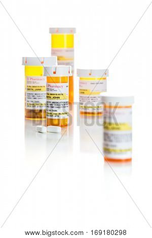 Non-Proprietary Medicine Prescription Bottles and Pills Isolated on a White Background. These are labels with fictitious information applied.
