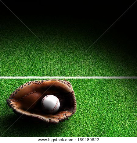 Baseball glove and ball on grass field with marking. Deliberate spot lighting effect and copy space.
