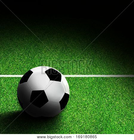 Soccer ball on field with marking. Deliberate spot lighting effect and copy space.