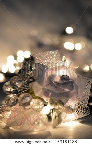 Christmas still life with boutonniere and light bokeh.