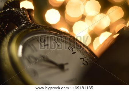 Christmas still life with clock with light bokeh.