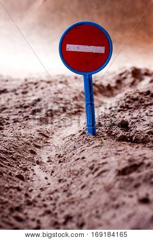 Prohibition sign on a ground desert road macro composition