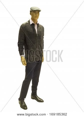 Full-length male mannequin dressed in jumper and trousers isolated on white background. No brand names or copyright objects.