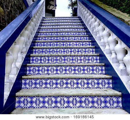 Old staircase balustrade with blue Portuguese tiles