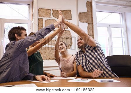 Business Team High Fiving Each Other