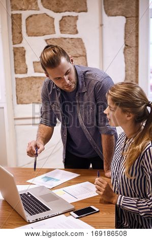Young Business Couple In A Meeting