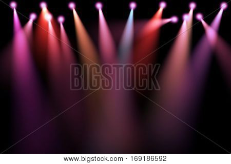 colorful stage lights projectors in the dark purpleredblue soft light spotlight strike on black background