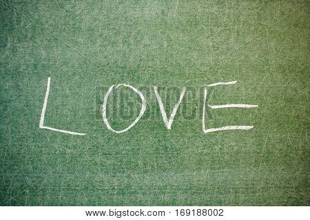 Handwritten message on a chalkboard at school: love