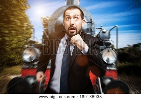 Businessman running away from a vintage train