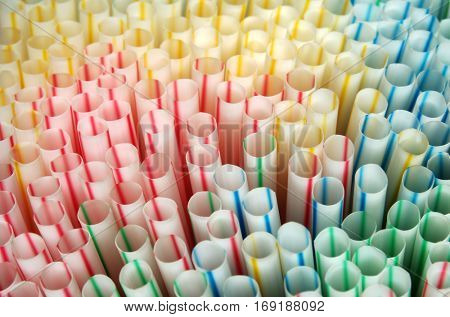 Closeup top view on many colorful plastic straws