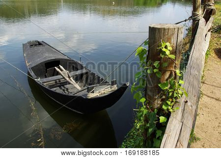 Countryside landscape with old row boat in the river shore