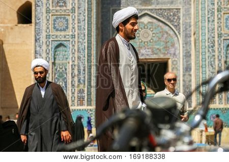 Iran Persia Yazd - September 2016: Local people near the mosque on the streets of the old town. Street photo.