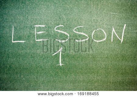Handwritten message on a chalkboard: lesson 1