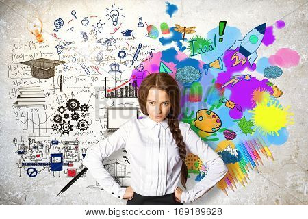 Confident young female on concrete background with mathematical formulas and colorful drawings. Creative and analytical thinking concept