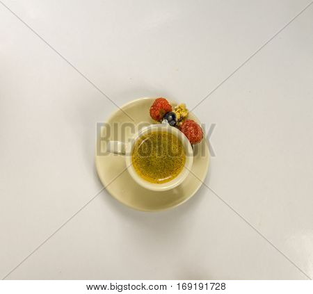 Black coffee in a cup of cream with juicy rasberry sweet set