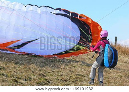 Paraglider preparing to do a reverse launch