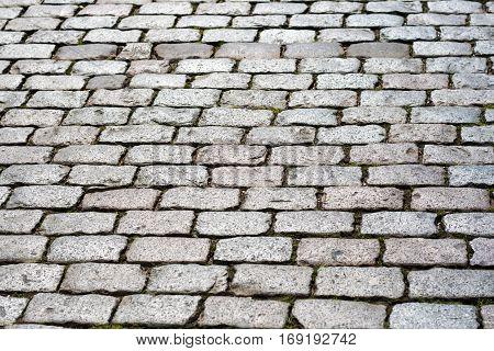 Background of sett bricks. Texture of Cobblestone pavement