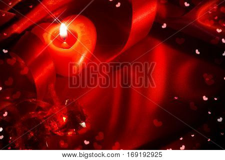 Valentine's Day background. Valentine Day frame design with red heart shaped candle, satin ribbon over red silk. Holiday Valentines gift greeting card backdrop