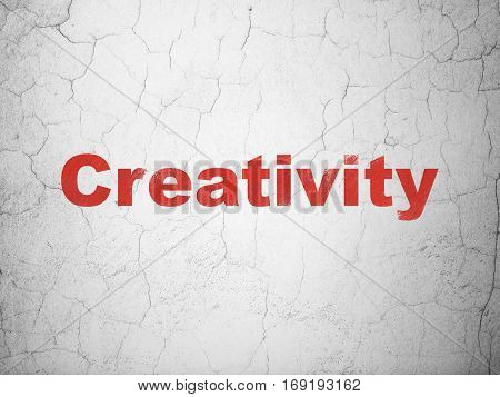 Advertising concept: Red Creativity on textured concrete wall background