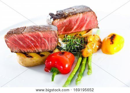 marble beef stake potatoes vegetables white plate