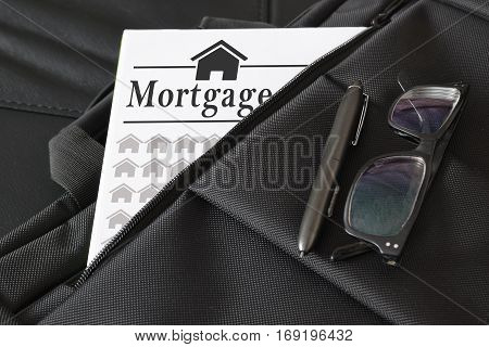 Briefcase containing some mortgage loan document. Empty copy space for Editor's text.