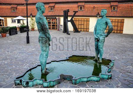 Prague, Czech Republic - June 20, 2012: Statue of pissing people in Kafka Museum in Prague