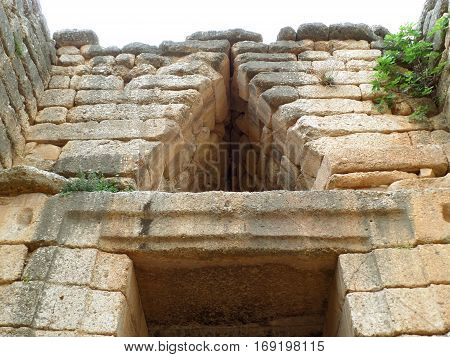 Relieving Triangle above the Doorway of the Beehive Tomb, Treasury of Atreus, Archaeological Site of Mycenae in Greece