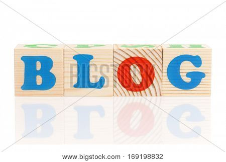 Blog word formed by colorful wooden alphabet blocks, isolated on white background