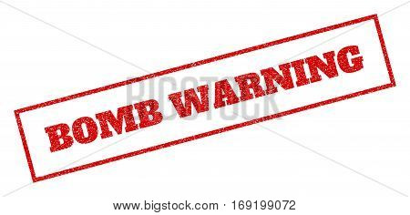 Red rubber seal stamp with Bomb Warning text. Vector tag inside rectangular banner. Grunge design and unclean texture for watermark labels. Inclined sign.