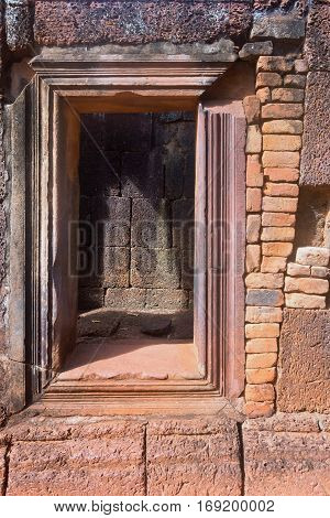 Cambodia a part of a wall historical the building or the temple with ancient window closeup
