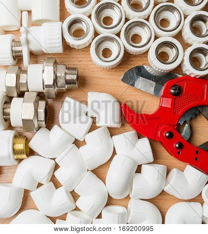 Set plumbing and tools on a white background. The fit adjustable wrench for plumbing pipes and fittings