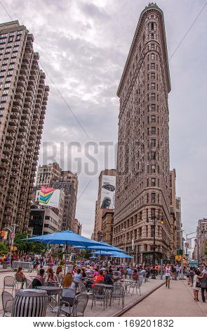 New York, USA - June 12, 2014: View of Flatiron Building on the street of Broadway in New York City