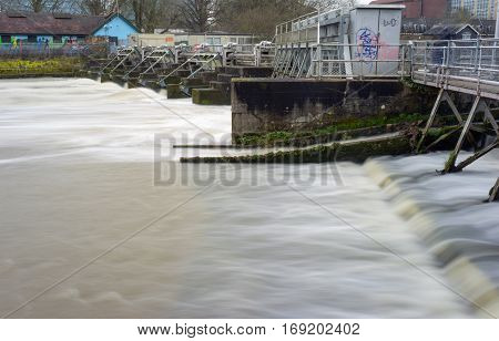 Rushing water at a Weir on the River Thames at Reading in Berkshire, UK.