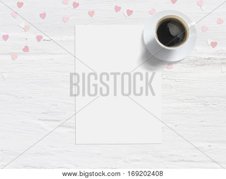 Baby shower, birthday day or wedding mockup scene with blank card, cup of coffee and paper heart confetti. Grunge white flat lay background, top view.