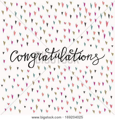 Congratulations calligraphy card with heart background. Hand written text.
