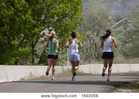 Three Friends On A Jogging Path