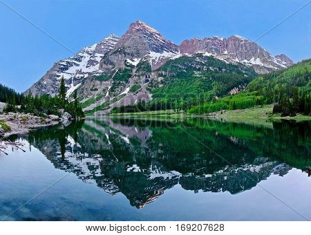 Maroon Bells peaks reflection in Crater Lake. Aspen. Snowmass Village. Colorado. United States.