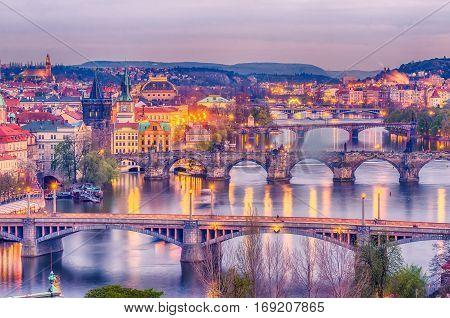 Prague, Czech Republic: romantic bridges that crosses Vltava river in the sunset