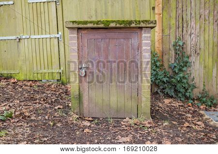 Locked wooden door for the underground path that covers all the park from one way to the other.
