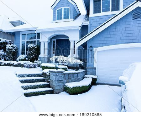 Front of home sidewalk during winter snow season