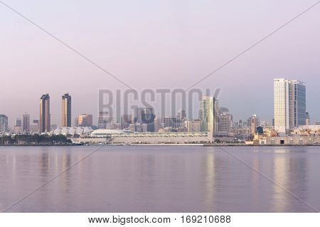 Modern San Diego skyline across the bay at dusk, California