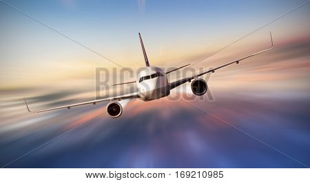 Commercial airplane flying above clouds in dramatic sunset light, blur motion. Very high resolution of image