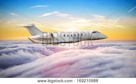 Private jet plane flying above clouds in beautiful sunset. Side view, high resolution image